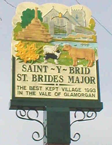 Village Sign St Brides Major/Saint-y-Brid depicting church & preaching cross and commemorating Best Kept Village award in 1993
